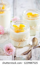 Jars of homemade vanilla pudding with rose extract