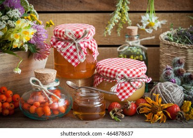 Jars of honey, bottles of healthy herbs and healing herbs bunches. Herbal medicine and nutraceuticals.