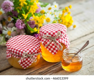 Jars of honey and healing herbs. Herbal medicine and nutraceuticals.