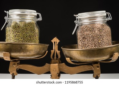 Jars with legumes on  vintage scales, a healthy eating concept