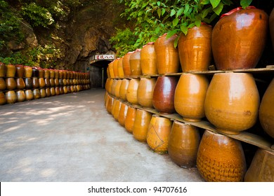 Jars line the entrance to old military tunnel, Tunnel 88 used for storage of locally distilled alcohol and spirits, now a tourist attraction on Nangan Island of Matsu in Taiwan. Horizontal