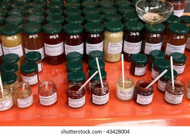 Jars of marmalade on shelves in market, Munich, Germany