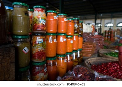 Jars of Peppers and Sauces in a Local Market in Maputo, Mozambique