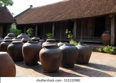 Jars of Tuong in ancient house yard, a kind of fermented bean paste made from soybean and commonly used in Vietnamese cuisine