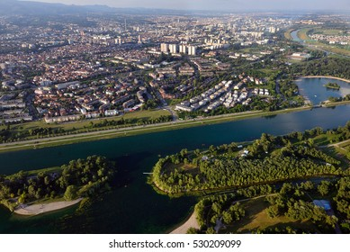 Jarun lake in Zagreb, Croatia, with the city center visible in the background.