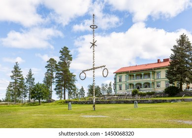 Jarvso, Sweden - June 28, 2019: A withered midsummer pole on the lawn at Stenegard which today is used as an arena for celebration of midsummer, markets etc.
