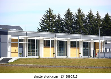 Jaslo, Poland - 9 3 2019: The modern sports hall of the village school. The eduction building of the younger generation. Walls with large glazed windows. Design solution for the facade of the build