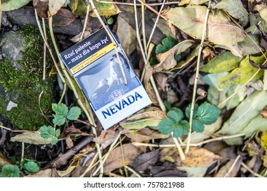Jaslo, Poland, October 31, 2017 pack of Nevada cigarettes, worn and thrown away, lusts health of man and nature, Nevada is brand owned by British American Tobacco plc BAT