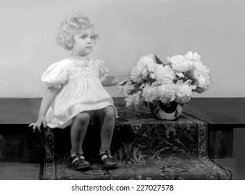 JASLO,POLAND - CIRCA 1948: vintage photo of girl  with peonies posy
