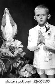 JASLO,POLAND - CIRCA 1950: vintage photo of boy receiving First Holy Communion