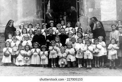 JASLO,POLAND - CIRCA 1951 : vintage photo of girls and nuns after religious procession during  Corpus Christi celebration