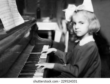 JASLO,POLAND - CIRCA 1953 : vintage photo of girl playing piano