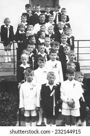 JASLO,POLAND - CIRCA 1960 : vintage photo of boys receiving First Holy Communion