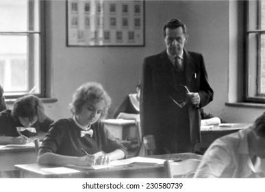 JASLO,POLAND - CIRCA 1962 : vintage photo of school-leavers taking an exam and teacher.