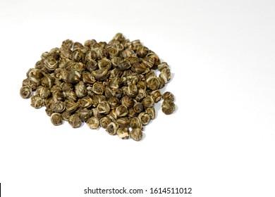 Jasmine dragon pearls long zhu green tea isolated on white