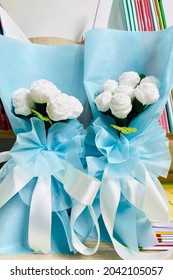 Jasmine flower and leaves made of fabric with blue ribbon