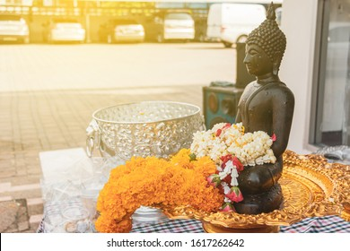Jasmine garland and marigold garland on Buddha Statue with Silver tray for Songkran day festival, Thailand.