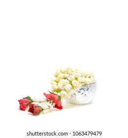 Jasmine garland on silver bowl isolated on white background, Symbolic of important day such as Songkran Festival and Mother's Dayin Thailand.