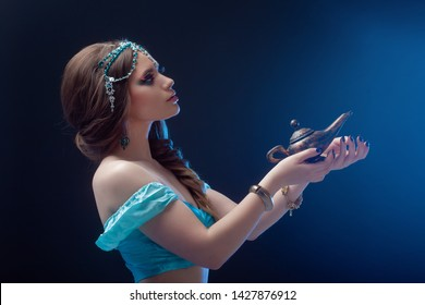 Jasmine the heroine of the Eastern fairy tale, Arab night, the girl calls gin and makes a wish.