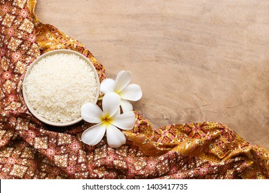 Jasmine rice in bowl on wooden table background