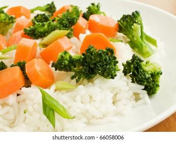 Jasmine rice with carrot and broccoli. Shallow dof.