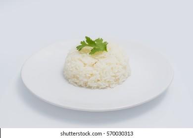 Jasmine rice on plate isolated white background