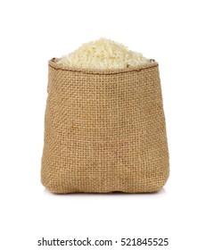 Jasmine rice in a small hemp sacks isolated on white background.