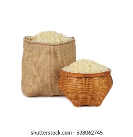 Jasmine rice in a small hemp sacks isolated on white background.