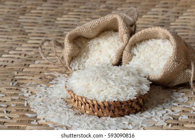Jasmine rice in wicker and sack cloth