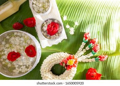 Jasmine and white rose garland On the background of green banana leaves. Songkran Festival in Thailand. Traditional of Thai.