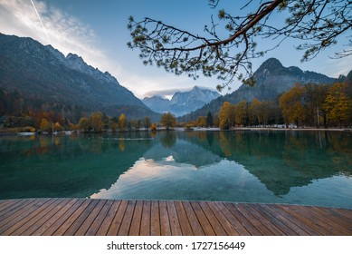 Jasna lake with beautiful reflections of the mountains and wooden pier. Triglav National Park, Slovenia