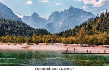 Jasna lake in Julian Alps, Kranjska gora. Wonderful summer landscape of Triglav National Park. Sunny scene of Julian Alps, Gozd Martuljek location, Slovenia, Europe. Awesome Nature Scenery