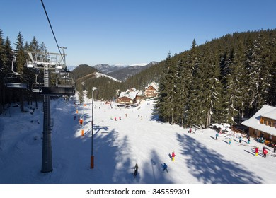 JASNA, SLOVAKIA - February 12: Aerial view of skiers and snowboarders enjoying on slopes of the best ski resort, Jasna, in Slovakia on February 12, 2015 in Jasna