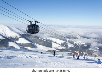 JASNA, SLOVAKIA - February 12: Modern cableway going from Priehyba to Rotunda, Chopok - 2024m, Funitel, in ski resort Jasna - Low Tatras mountains on February 12, 2015 in Jasna