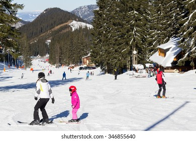 JASNA, SLOVAKIA - February 12: A mother teaching her daughter to ski in best ski resort, Jasna, in Slovakia on February 12, 2015 in Jasna