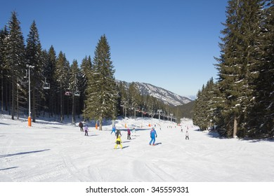 JASNA, SLOVAKIA - February 12: Skiers and snowboarders enjoying on slopes of the best ski resort, Jasna, in Slovakia on February 12, 2015 in Jasna