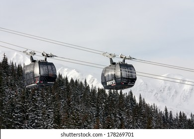JASNA, SLOVAKIA - February 13: Modern cableway going from Priehyba to Rotunda, Chopok - 2024m, Funitel, in ski resort Jasna - Low Tatras mountains on February 13, 2014 in Jasna