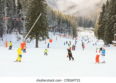 JASNA, SLOVAKIA - February 13: Skiers and snowboarders enjoying on slopes of the best ski resort, Jasna, in Slovakia on February 13, 2014 in Jasna