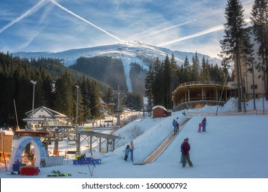 Jasna, Slovakia - January 18, 2019: Jasna ski resort in Low Tatras, Slovakia (Slovensko). Beautiful winter sunny day on famous place with Chopok mount view