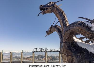 JASNA, SLOVAKIA - October 05, 2018. Jasna, sculpture of a three-headed dragon at the station Jasna - Chopok. Nizke Tatry, Low Tatras, Low Tatra mountains, Slovakia