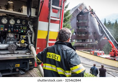 JASNA, SLOVAKIA - OCTOBER 6: Fireman  in front of hotel Junior Jasna  in Low Tatras mountains on October 6, 2015 in Jasna