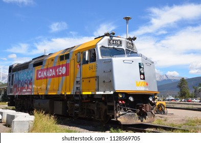 JASPER, AB / CANADA - JULY 25, 2017:  A locomotive with Canada 150 decoration on it rests in a train track in Jasper, Alberta.