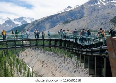 JASPER, ALBERTA, CANADA, JUNE 27, 2016: Tourists at the Glacier Skywalk, Columbia Icefield Parkway Rocky Mountains, Jasper National Park, Alberta, Canada