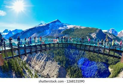 JASPER, ALBERTA, CANADA - OCTOBER 3,2017: Tourists at Glacier Skywalk, Columbia Icefield Rocky Mountains, Jasper National Park,Alberta, Canada