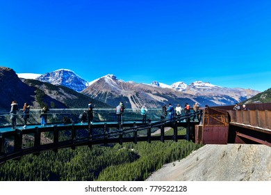 JASPER, ALBERTA, CANADA - OCTOBER 3,2017: Tourists at Glacier Skywalk, Columbia Icefield Rocky Mountains, Jasper National Park,Alberta, Canada