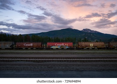 JASPER, CANADA - SEPTEMBER 5, 2016: view eastwards towards Signal Mountain and Mount Tekarra, with rail cars in the foreground.
