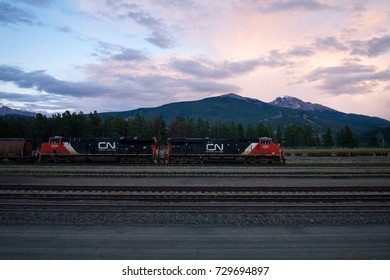 JASPER, CANADA - SEPTEMBER 5, 2016: view eastwards towards Signal Mountain and Mount Tekarra, with rail locomotive in the foreground.