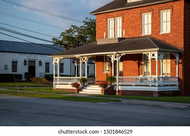 Jasper, Florida - May 17, 2019: A restored 19th century brick home sits along the site of the former Florida Branch Railroad, now a public walking trail.