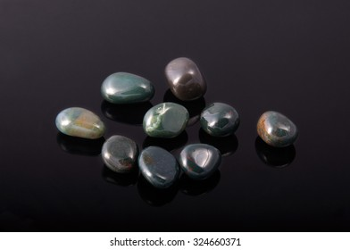 jasper heliotrope, bloodstone. Gemstone on black