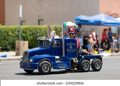 Jasper, Indiana, USA - August 5, 2018: The Strassenfest Parade, Members of LA-OR-MA Shrine Club, Hiram's Hotrods from Bedford, Indiana, driving mini cars down the road